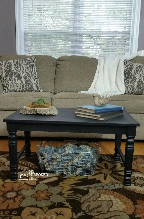 black coffee table makes a great bench for extra seating-made from chair legs and hardwood flooring MyRepurposedLife.com