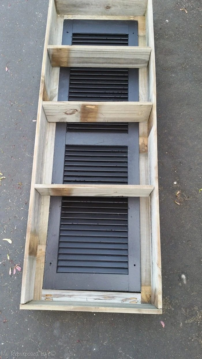 add shelves to rustic shutter cabinet