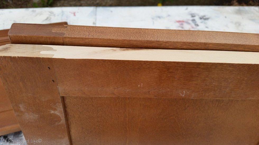 ripped cabinet door edge