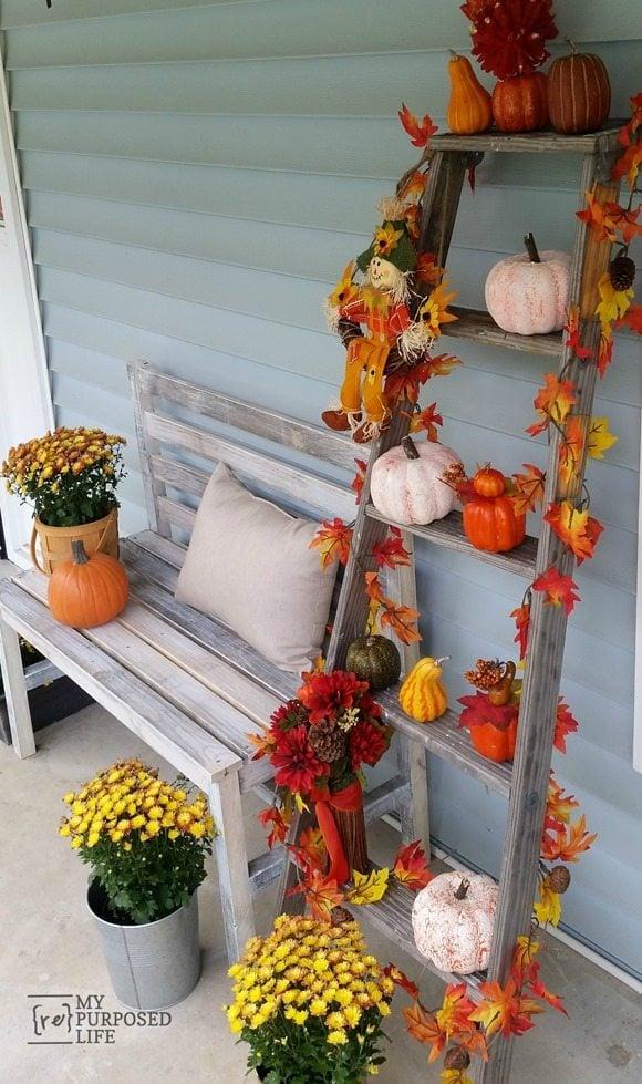 rustic fall porch DIY wooden slat bench MyRepurposedLife.com