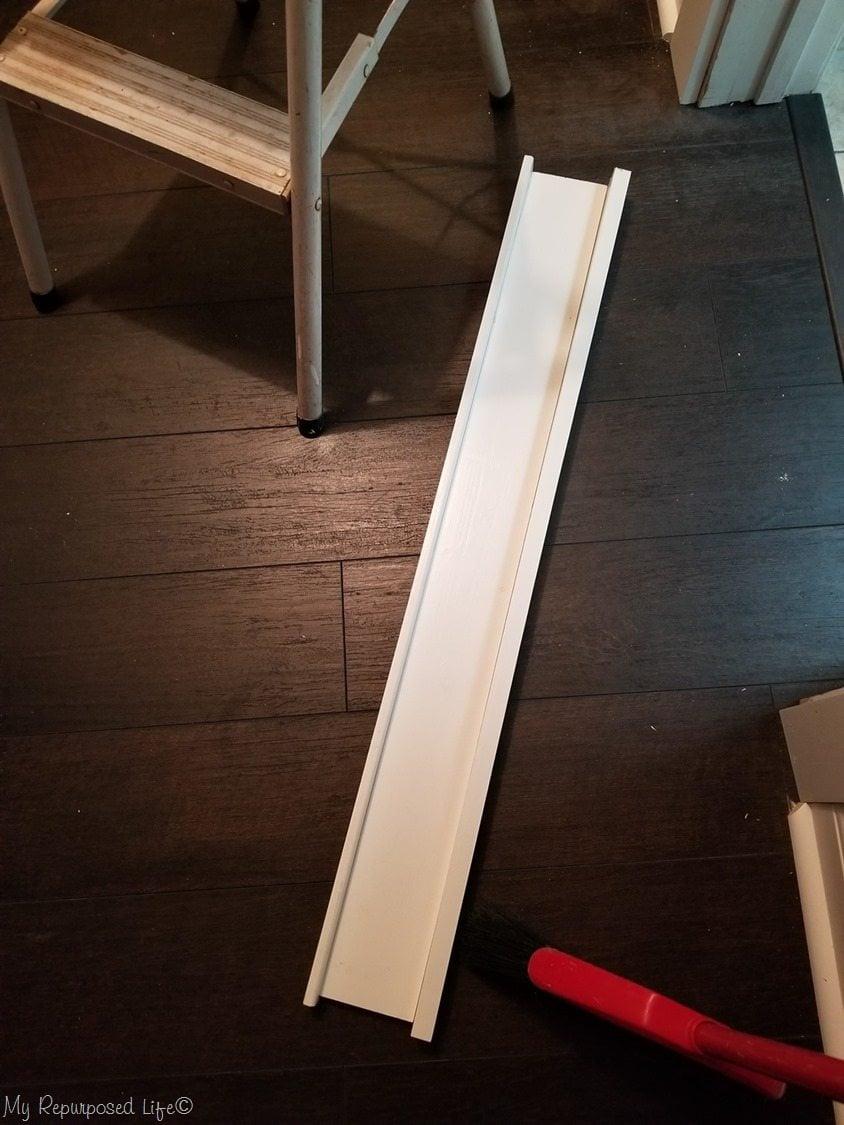 build header before installing craftsman style door trim