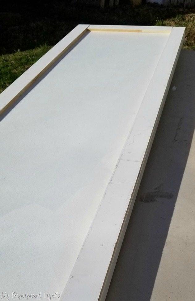 add trim flat panel door to make faux barn door