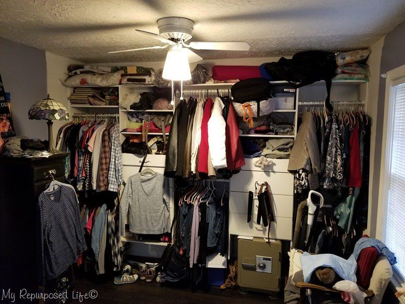 messy wall to wall master closet needs new doors