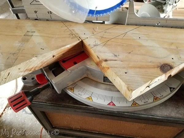 cut reclaimed stair stringer on compound miter saw