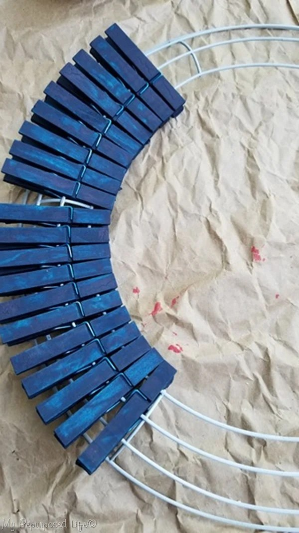 clip painted wooden clothespins on wire wreath frame