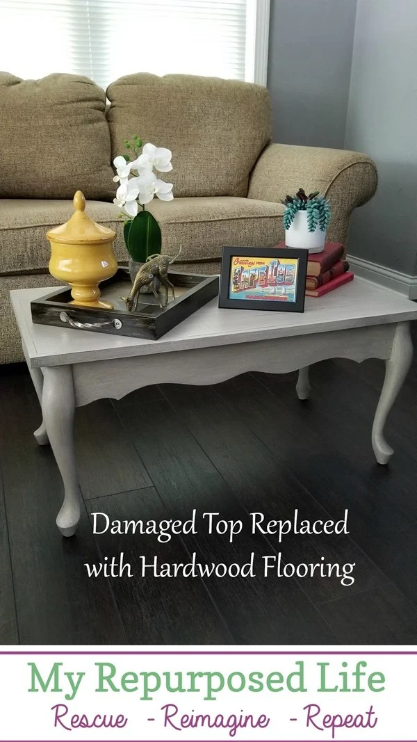 damaged queen anne coffee table top replaced with hardwood flooring MyRepurposedLife.com