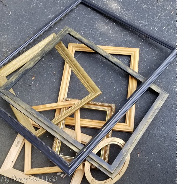 pile of thrift store picture frames