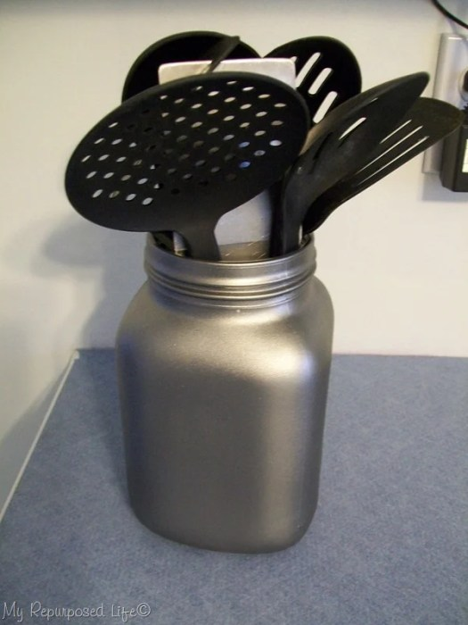 spray painted glass jar to hold kitchen accessories