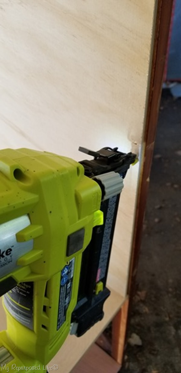 attach bookcase sides with nail gun