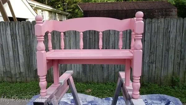 small pink wooden child bench