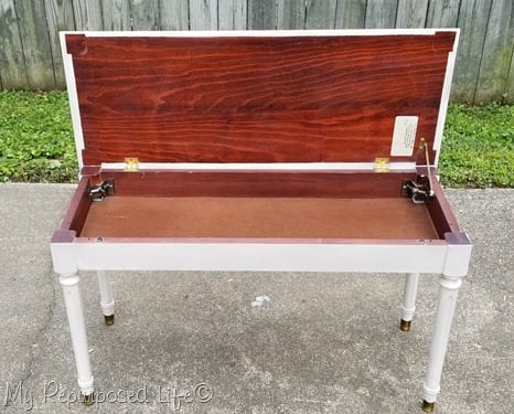 white piano bench with lid open