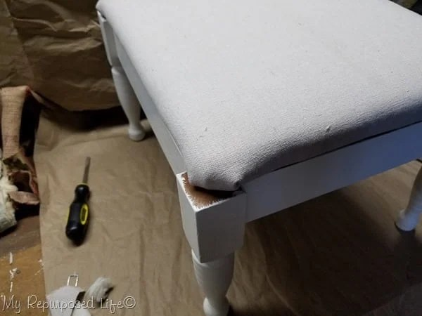 dry fit new upholstered footstool top on base of stool