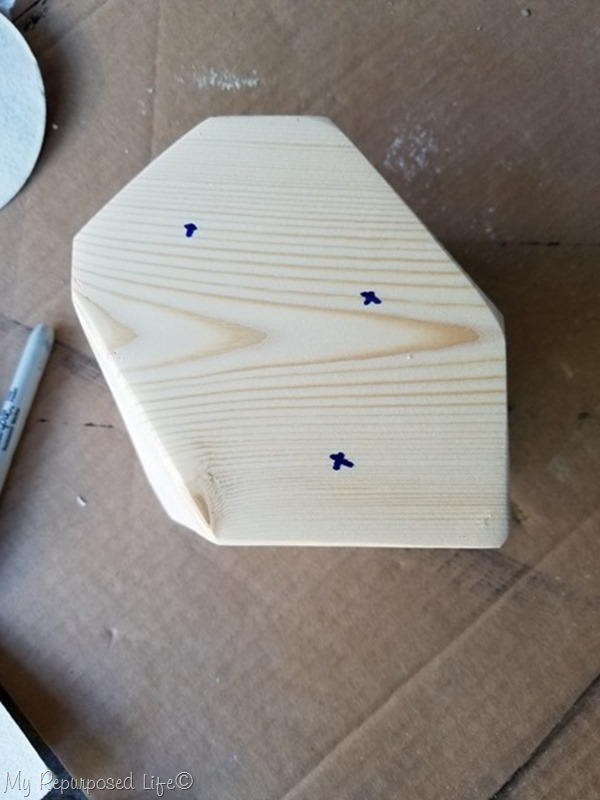 mark wooden candle holder for drilling