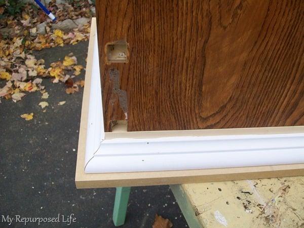 add trim to repurposed desk lingerie cabinet