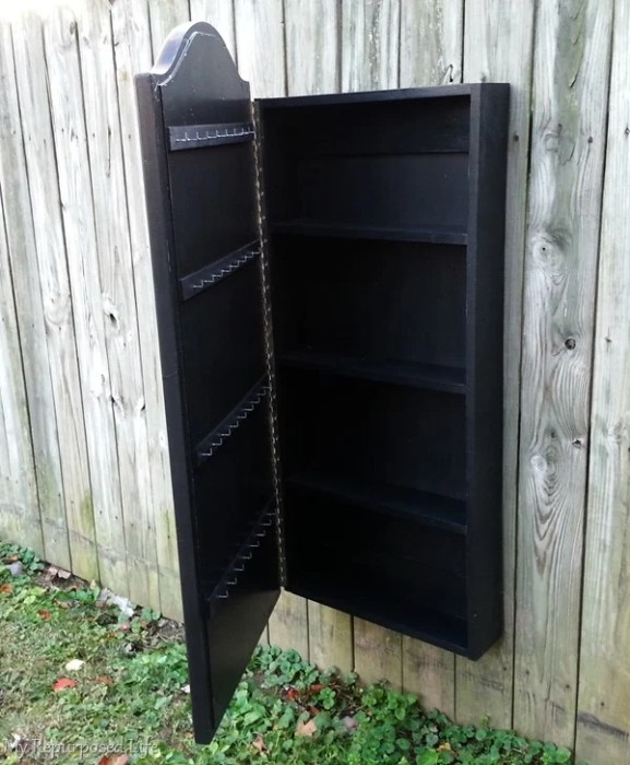 black jewelry wall cabinet made from a thrift store mirror