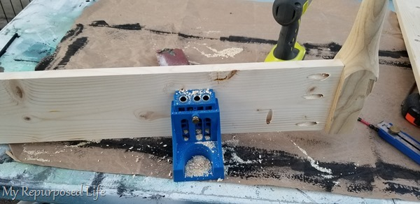 drill pocket holes on cross board to attach wall shelf board