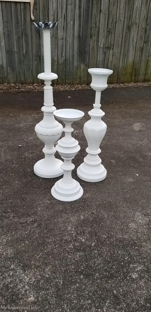 repurposed lamps into candlesticks and plant stands