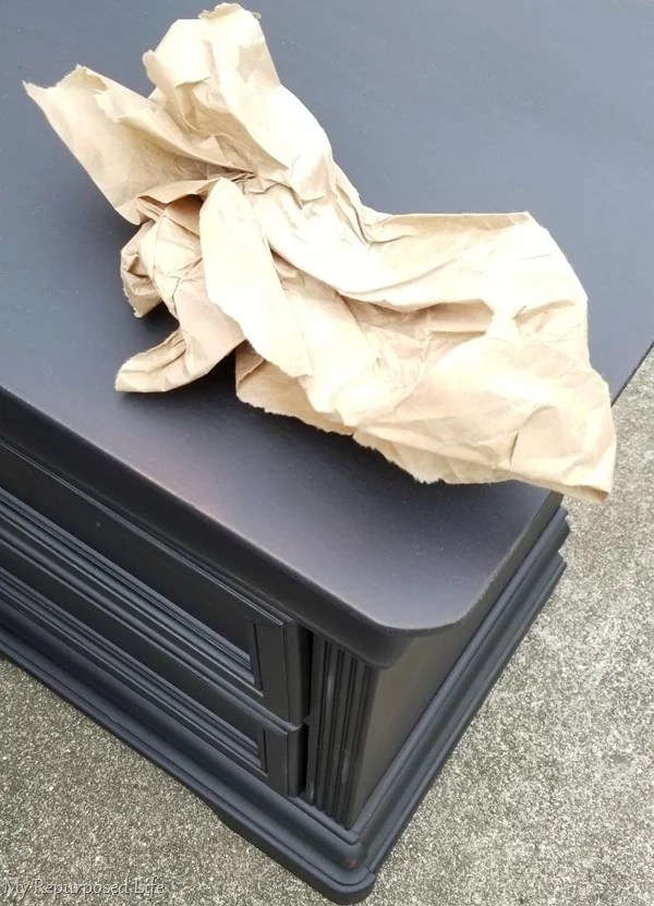 use packing paper to sand smooth vintage black nightstands