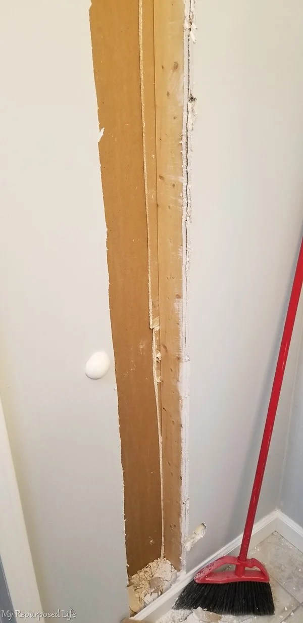 narrow stud opening in broom closet between the studs project