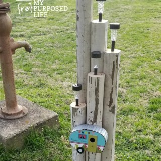 how to make a lighting feature using dollar store solar lights and landscape timbers MyRepurposedLife