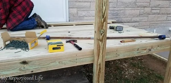 pipe clamp helps hold deck boards
