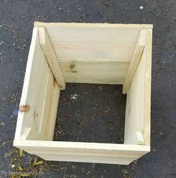 simple wooden planter to cover up ugly plastic flower pot