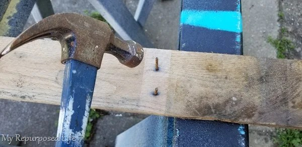 tap nails out of pallet board