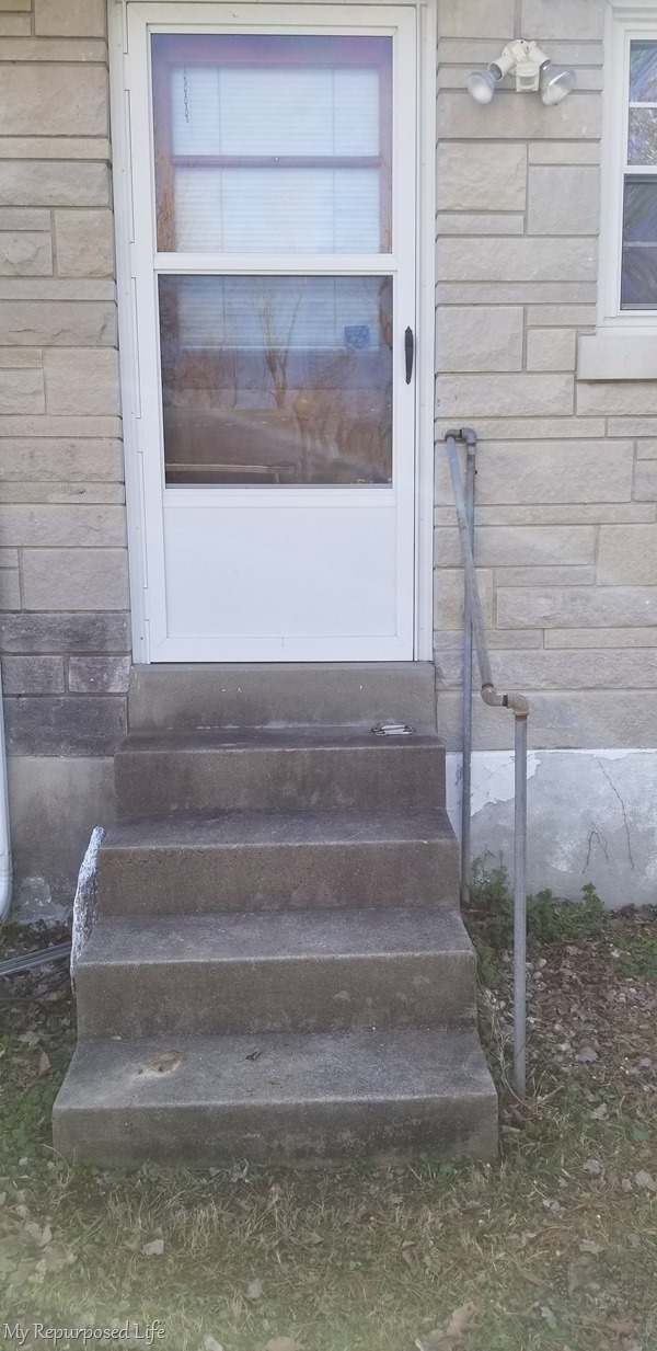 ugly concrete steps disguised with small deck