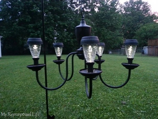 use solar lights on repurposed chandelier
