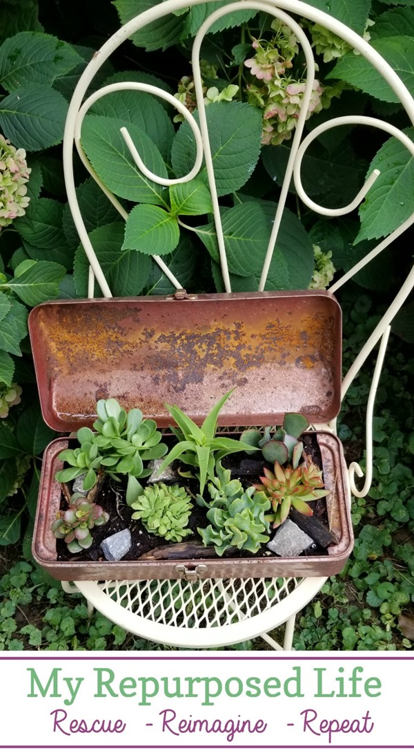 metal ice cream chair with vintage toolbox planter holding succulents MyRepurposedLife