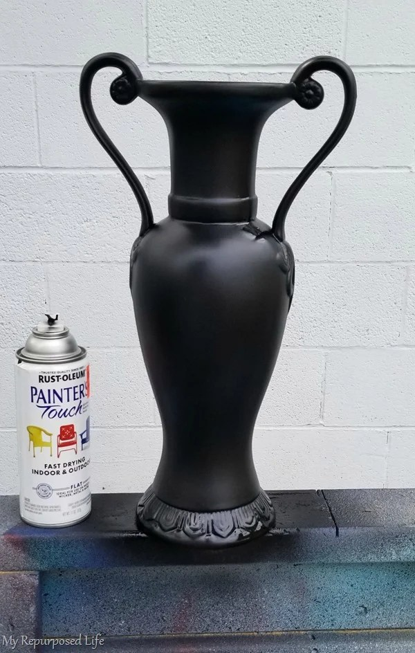 over sized vase with black spray paint