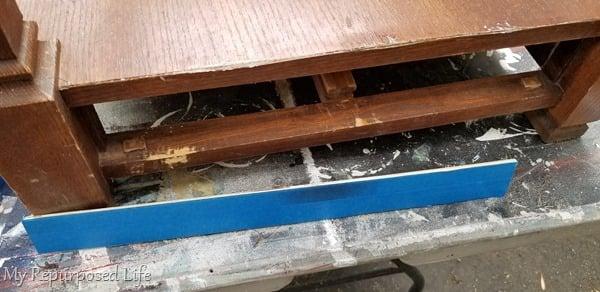 use blue tape on scrap wood to mend broken veneer