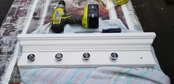 adding knobs to jewelry shelf