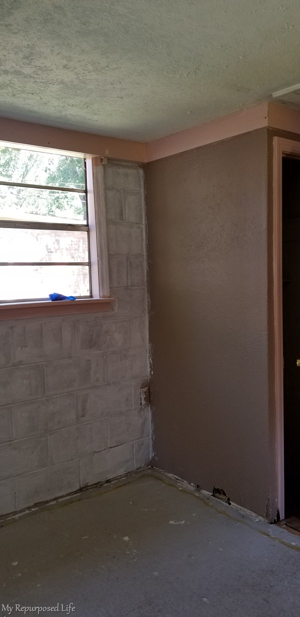 painting concrete cinder block wall by hand