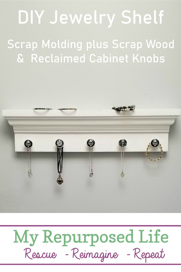 A simple DIY jewelry shelf is made from scrap molding and reclaimed cabinet knobs that have been decoupaged. #MyRepurposedLife #jewelry #shelf #hooks #reclaimed #repurposed #furniture via @repurposedlife