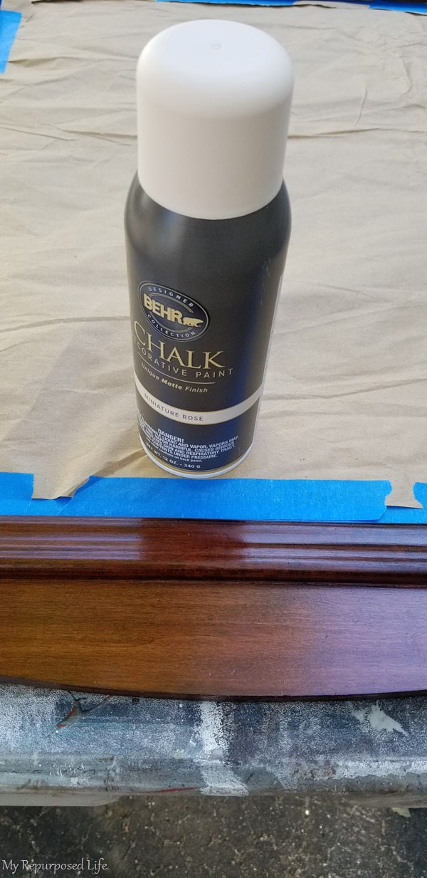 add paper to protect mirror from spray paint