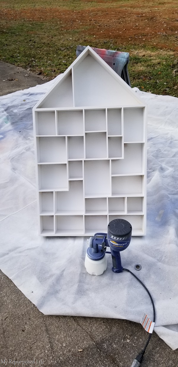 paint cubby wall shelf with paint sprayer