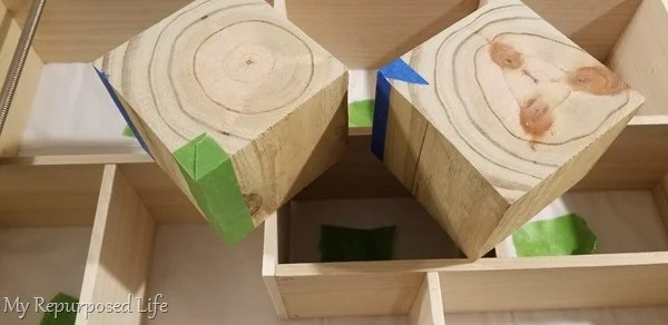 tape corners of wooden blocks