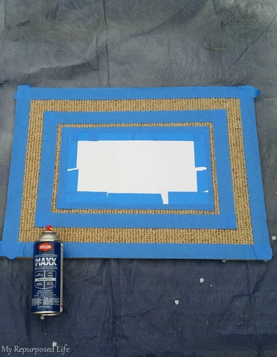 spray paint welcome mat on a tarp