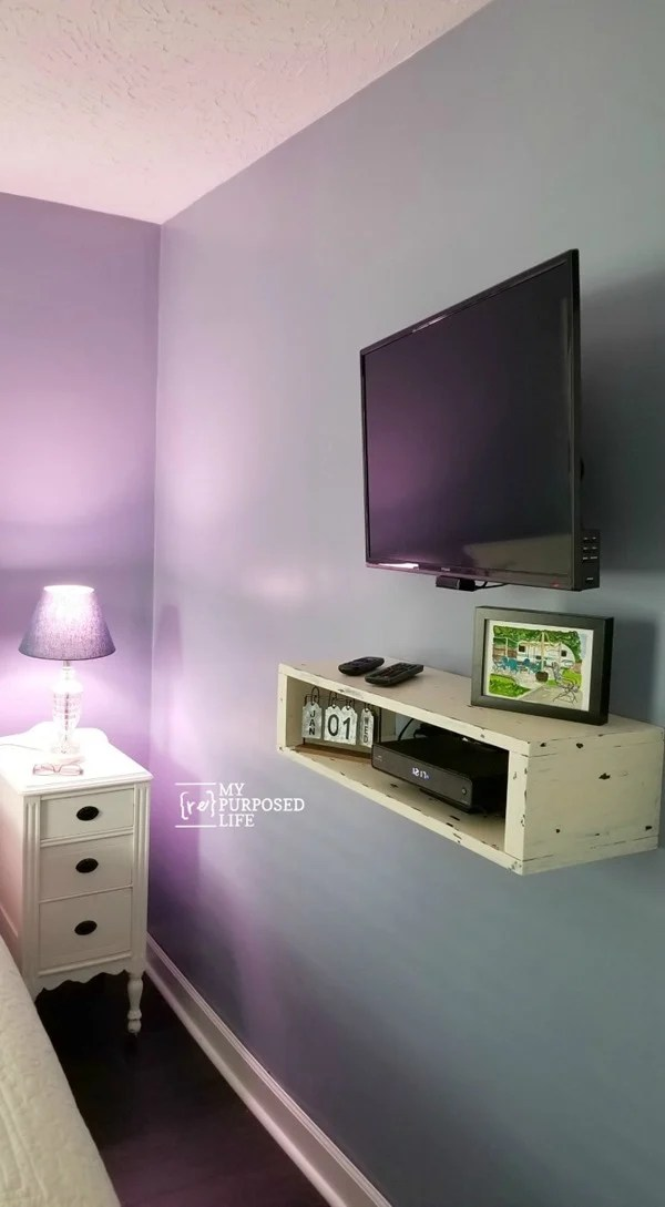 Solving the cord issue when hanging a t.v. on the wall can be quite challenging. I didn't have room for a media center, so I built a floating shelf. All directions included in this tutorial. Bonus: Fishing the wires #MyRepurposedLife #organization #letsgetorganized #bloggerchallenge via @repurposedlife