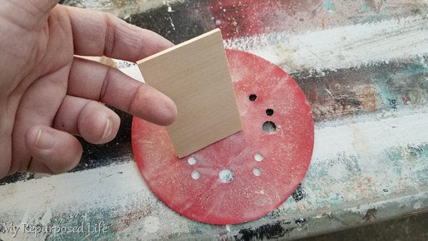 lightly sand wooden discs