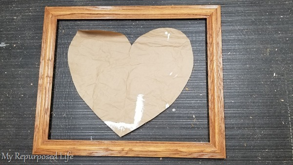 paper heart in wooden picture frame