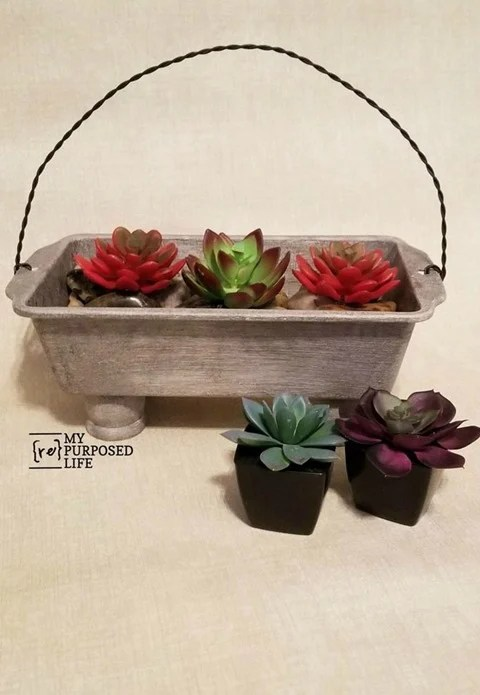 How to make a loaf pan planter for succulents and add a twisted wire handle. Tips on making a twisted wire handle with your cordless drill. Video tutorial for wire handle and picture tutorial for loaf pan planter. #MyRepurposedLife #repurposed #loaf #pan #planter via @repurposedlife
