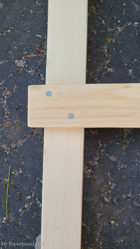 adding nails to farmhouse ladder