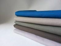 verschiedene Stoffe für Couchküsschen