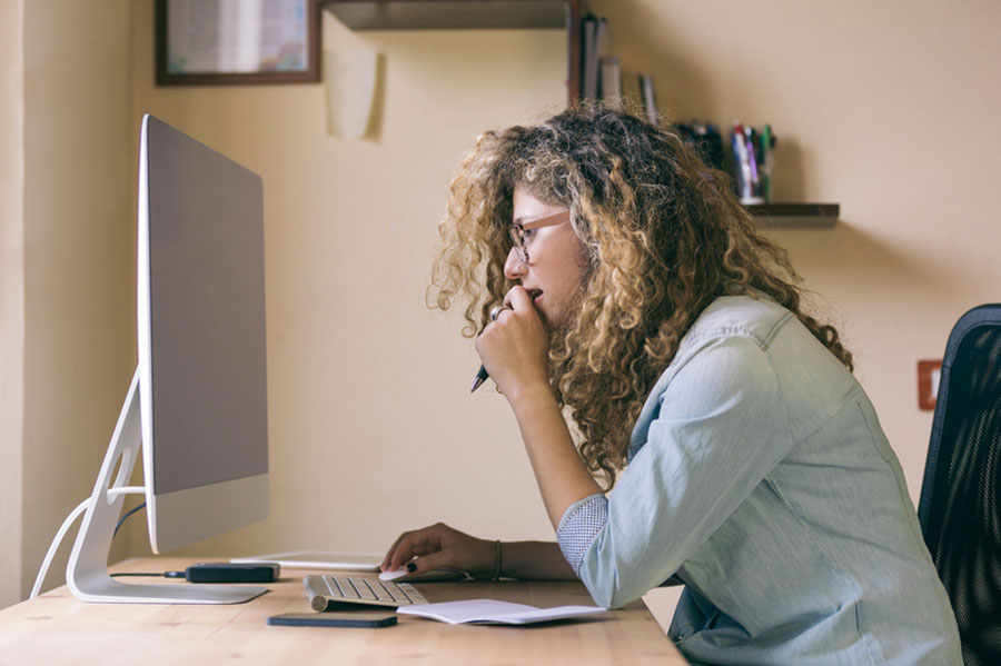 Female sitting at a computer