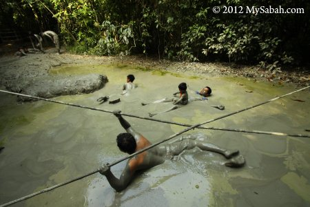 enjoying mud volcano bath in Pulau Tiga