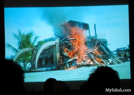 burning logging dozer