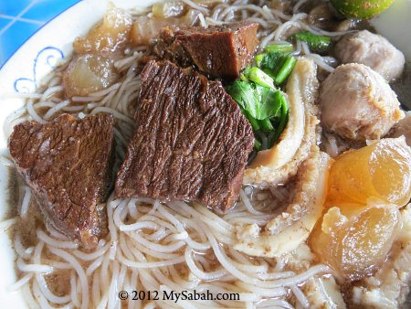 close-up of ngiu chap / beef noodle soup