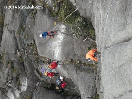 practising rock climbing